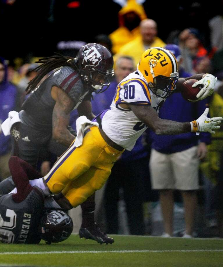 LSU wide receiver Jarvis Landry leaps pulls away for the touchdown as he's brought down by Texas A&M defensive backs Floyd Raven Sr., and Deshazor Everett. Photo: Cody Duty, Houston Chronicle