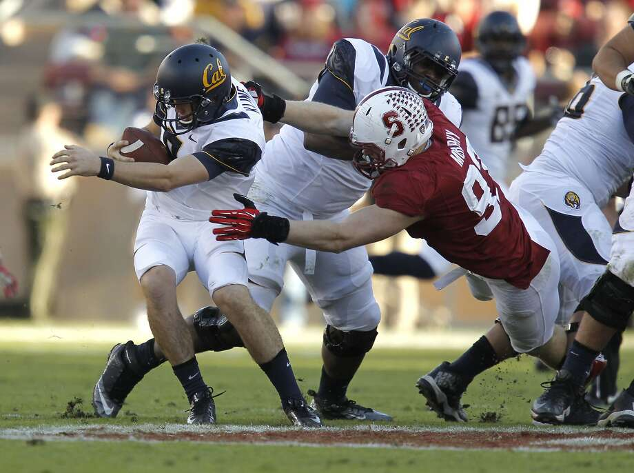 Stanford's Trent Murphy, (93) with a sack of Cal quarterback Zach Kline, (8) in the third quarter, as the Stanford Cardinal went on to beat the California Golden Bears 63-13 in the 116th Big Game match up on Saturday Nov. 23, 2013 at Stanford stadium in Palo Alto, Ca. Photo: Michael Macor, The Chronicle