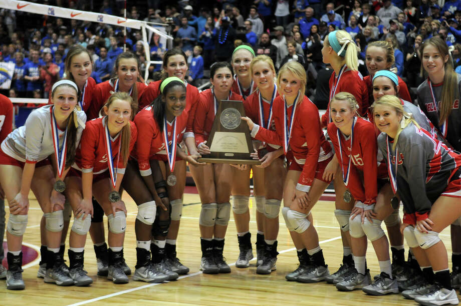 Bellville senior Hannah Baker, center, and her Brahmanette teammates show off their 2nd place trophy after losing in 4 sets to the Decatur Eagles in the finals of the Class 3A 2013 UIL State Volleyball Championships at the Culwell Center in Garland on Saturday. Photo: Jerry Baker, For The Chronicle