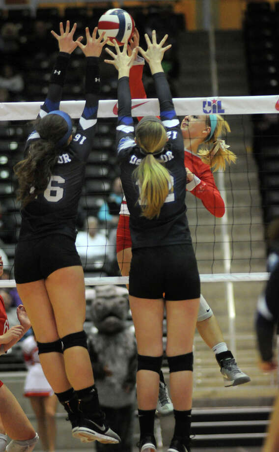 Bellville sophomore Reilly Kuenstler, right, skies for a kill against Decatur's Caroline Lowery, from left, and Katie Isham during the finals of the Class 3A 2013 UIL State Volleyball Championships at the Culwell Center in Garland on Saturday. Photo: Jerry Baker, For The Chronicle