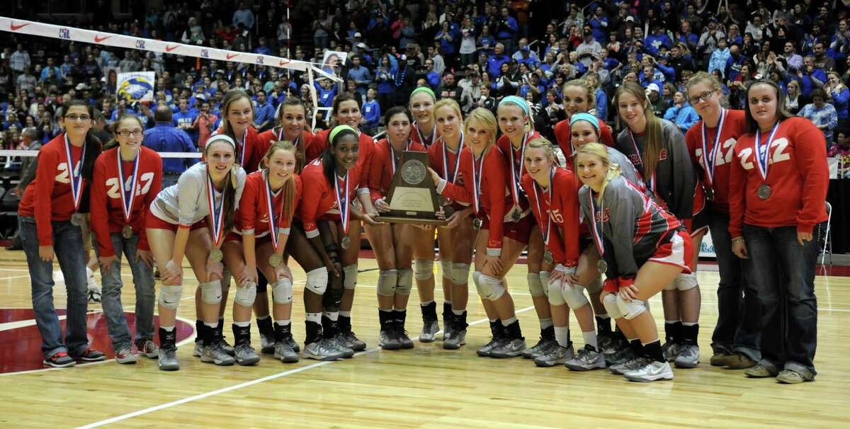 Bellville senior Hannah Baker, center, and her Brahmanette teammates show off their 2nd place trophy after losing in 4 sets to the Decatur Eagles in the finals of the Class 3A 2013 UIL State Volleyball Championships at the Culwell Center in Garland on Saturday.