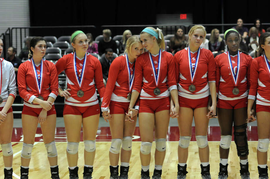 Bellville senior Rachel Kuenstler rests her head on the shoulder of her sister, sophomore Reilly Kuenstler, during the award ceremony after the Brahmanettes lost to Decatur in 4 sets in the finals of the Class 3A 2013 UIL State Volleyball Championships at the Culwell Center in Garland on Saturday. Photo: Jerry Baker, For The Chronicle