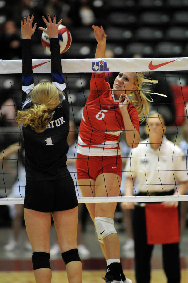 Bellville senior Lorin Robertson, right, works for a kill against Decatur junior Stormi Leonard during the finals of the Class 3A 2013 UIL State Volleyball Championships at the Culwell Center in Garland on Saturday. Photo: Jerry Baker, For The Chronicle