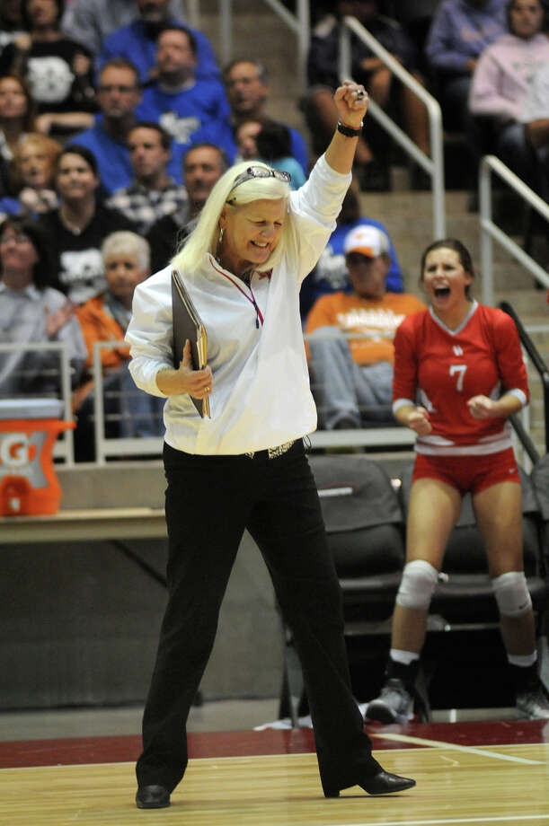 Bellville Head Coach Susan Brewer celebrates a point against Decatur during the finals of the Class 3A 2013 UIL State Volleyball Championships at the Culwell Center in Garland on Saturday. Photo: Jerry Baker, For The Chronicle