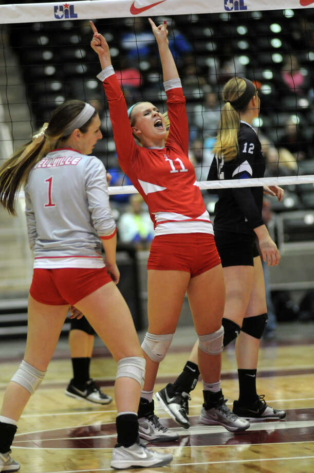 Bellville sophomore Reilly Kuenstler, center, with teammate Keeton Holcomb, left,  a junior, celebrates a point against Decatur during the finals of the Class 3A 2013 UIL State Volleyball Championships at the Culwell Center in Garland on Saturday. Photo: Jerry Baker, For The Chronicle