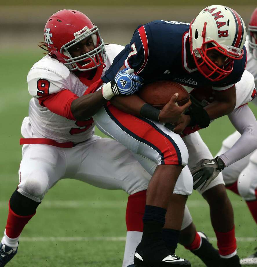 Alief Taylor's Landell Johnsn (9) sacks Lamar quarterback Darrell Colbert (7) during the first half of a high school football playoff game, Saturday, November 23, 2013, at Delmar Stadium in Houston. Photo: Eric Christian Smith, For The Chronicle