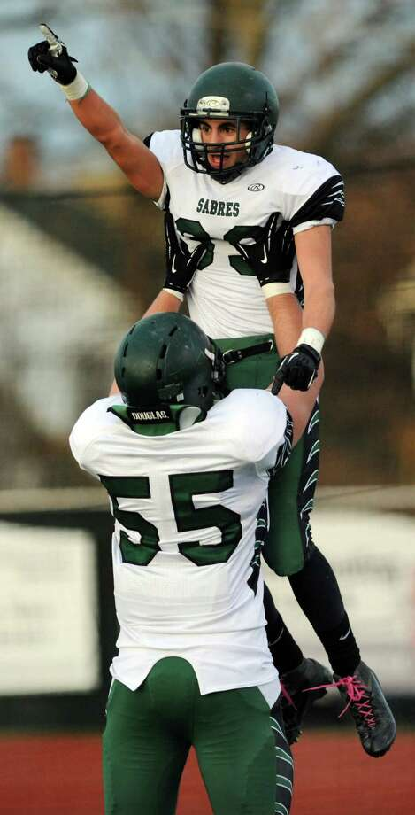Schalmont's Hunter Gac, top, celebrates a touch down with Marcus Ramundo during their Class B state semifinal football game against Marlboro on Saturday, Nov. 23, 2013, at Dietz Stadium in Kingston, N.Y. Schalmont wins 66-0. (Cindy Schultz / Times Union) Photo: Cindy Schultz / 00024746A