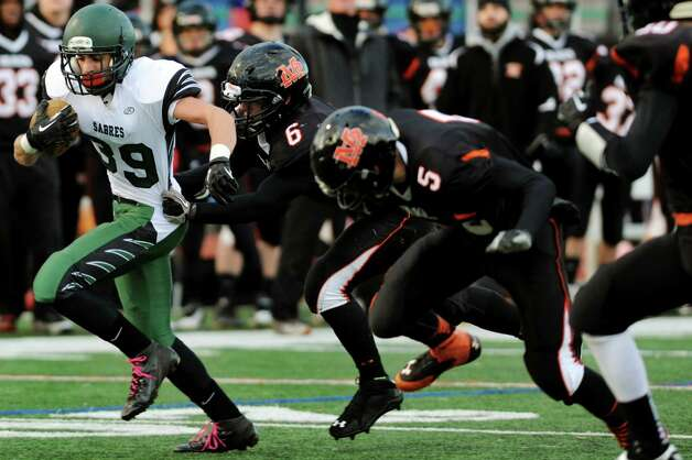 Schalmont's Hunter Gac, left, carries the ball during their Class B state semifinal football game against Marlboro on Saturday, Nov. 23, 2013, at Dietz Stadium in Kingston, N.Y. (Cindy Schultz / Times Union) Photo: Cindy Schultz / 00024746A
