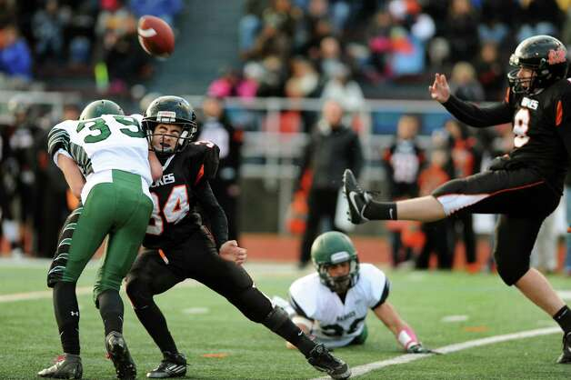 Schalmont's Hunter Gac, left, blocks a punt from Marlboro's Michael Greaven, right, as his teammate Sam Galage, center, blocks during their Class B state semifinal football game on Saturday, Nov. 23, 2013, at Dietz Stadium in Kingston, N.Y. (Cindy Schultz / Times Union) Photo: Cindy Schultz / 00024746A