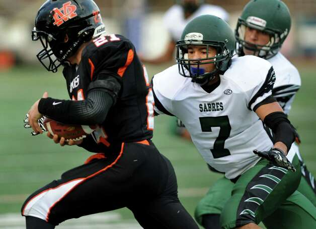 Schalmont's Trevon Perez-Tucker, center, gets set to tackle Marlboro's Ryan Cary during their Class B state semifinal football game on Saturday, Nov. 23, 2013, at Dietz Stadium in Kingston, N.Y. (Cindy Schultz / Times Union) Photo: Cindy Schultz / 00024746A
