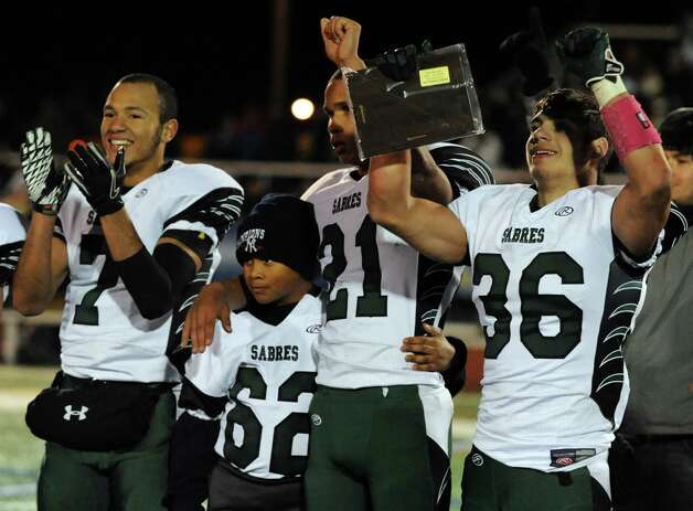 Schalmont teammates Trevon Perez-Tucker, left, Devon Willis, center, and quarterback Nick Gallo celebrate their 66-0 win over Marlboro in the Class B state semifinal football game on Saturday, Nov. 23, 2013, at Dietz Stadium in Kingston, N.Y. (Cindy Schultz / Times Union) Photo: Cindy Schultz / 00024746A