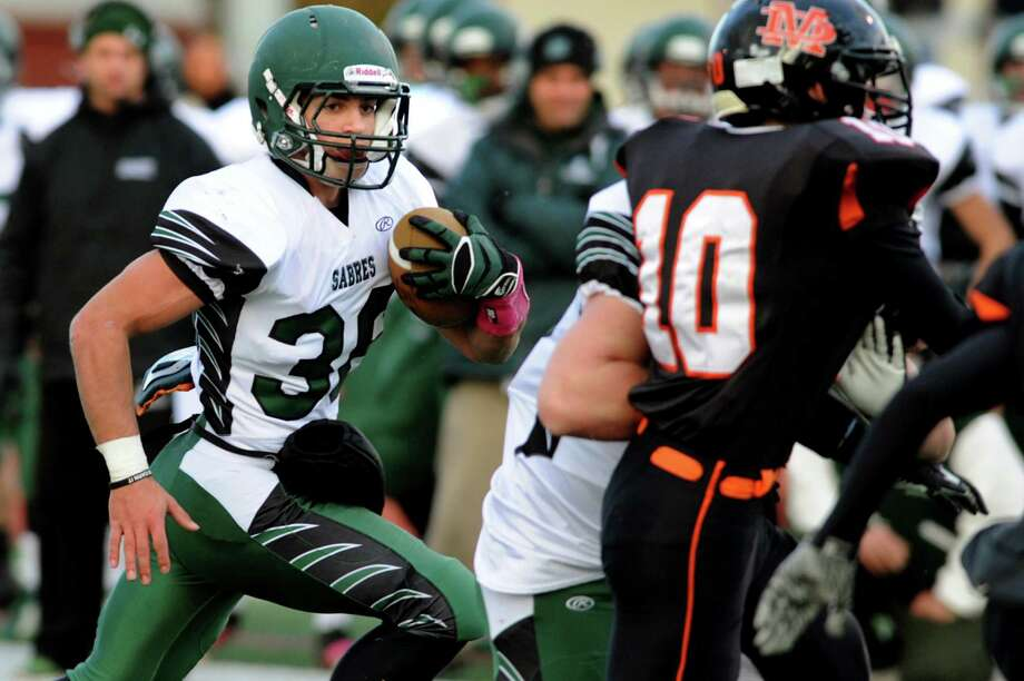 Schalmont's quarterback Nick Gallo, left, carries the ball during their Class B state semifinal football game against Marlboro on Saturday, Nov. 23, 2013, at Dietz Stadium in Kingston, N.Y. (Cindy Schultz / Times Union) Photo: Cindy Schultz / 00024746A