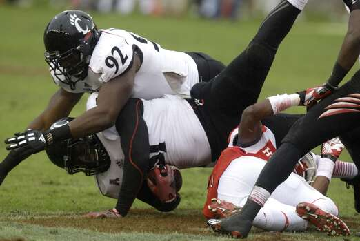 Greg Blair of Cincinnati recovers a fumble against UH. Photo: J. Patric Schneider, For The Chronicle