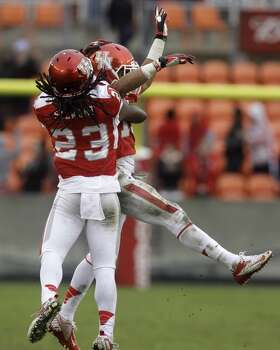 UH defensive back Adrian McDonald celebrates with teammate Trevon Stewart after making an interception against Cincinnati. Photo: J. Patric Schneider, For The Chronicle