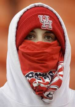 A UH fan braves the cold weather to watch the Cougars face Cincinnati. Photo: J. Patric Schneider, For The Chronicle