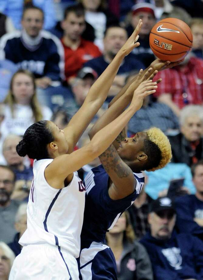 Connecticut's Kiah Stokes (41) guards Monmouth's Christina Mitchell  during the first half of an NCAA college basketball game, in Storrs, Conn., on Saturday, Nov. 23, 2013. Photo: Fred Beckham, AP / Associated Press