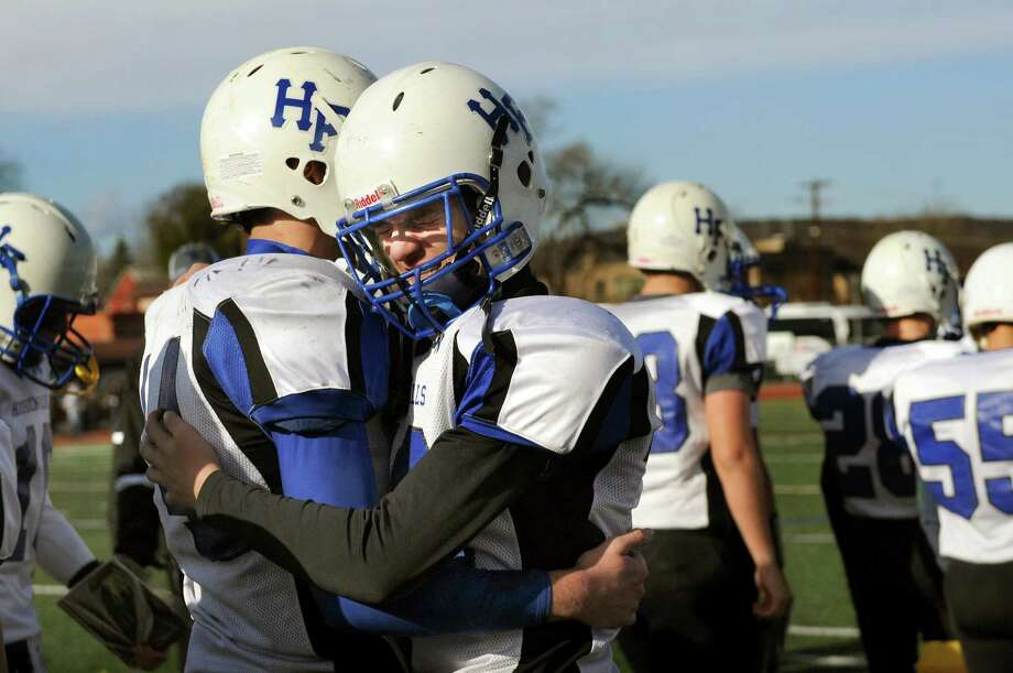 Hoosick Falls' Kellan Skott, center, and Levi Brewster react to their 14-0 loss to Rye Neck in their Class C state semifinal football game on Friday, Nov. 22, 2013, at Dietz Stadium in Kingston, N.Y. (Cindy Schultz / Times Union) Photo: Cindy Schultz / 00024747A