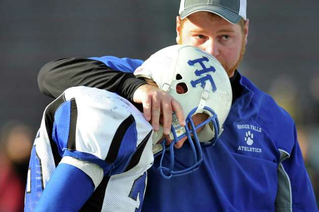 Hoosick Falls' assistant coach Eamonn Degraaf, right, tries to console Thomas Peabody after their 14-0 loss to Rye Neck in their Class C state semifinal football game on Saturday, Nov. 23, 2013, at Dietz Stadium in Kingston, N.Y. (Cindy Schultz / Times Union) Photo: Cindy Schultz / 00024747A