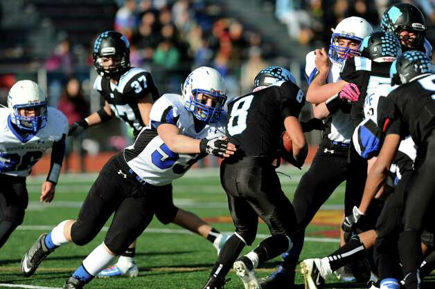 Hoosick Falls' Shayne Richard, center, grabs ahold of Rye Neck's ball carrier Jake Sevean during their Class C state semifinal football game on Saturday, Nov. 23, 2013, at Dietz Stadium in Kingston, N.Y. (Cindy Schultz / Times Union) Photo: Cindy Schultz / 00024747A