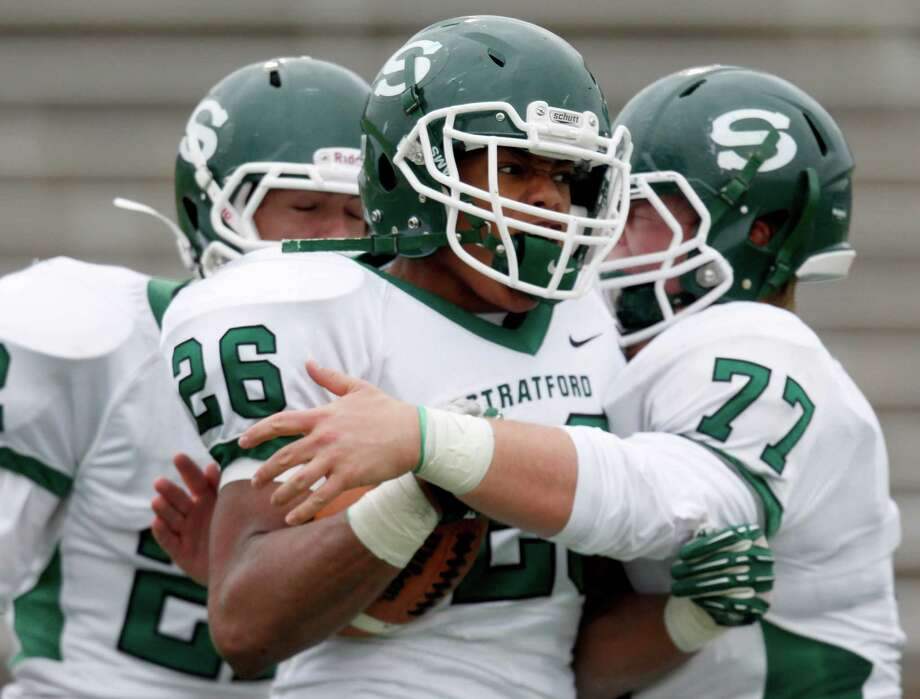 11/23/13: Stratford Spartan Rakeem Boyd (26) is congratulated by Wade Touchstone (77) after scoring a touchdown against the  Friendswood Mustangs defense in the Class 4 A Division One Play-Off game at Mercer Stadium in Sugarland, Texas. Stratford won 34 to 7. Photo: Thomas B. Shea, For The Chronicle / © 2013 Thomas B. Shea
