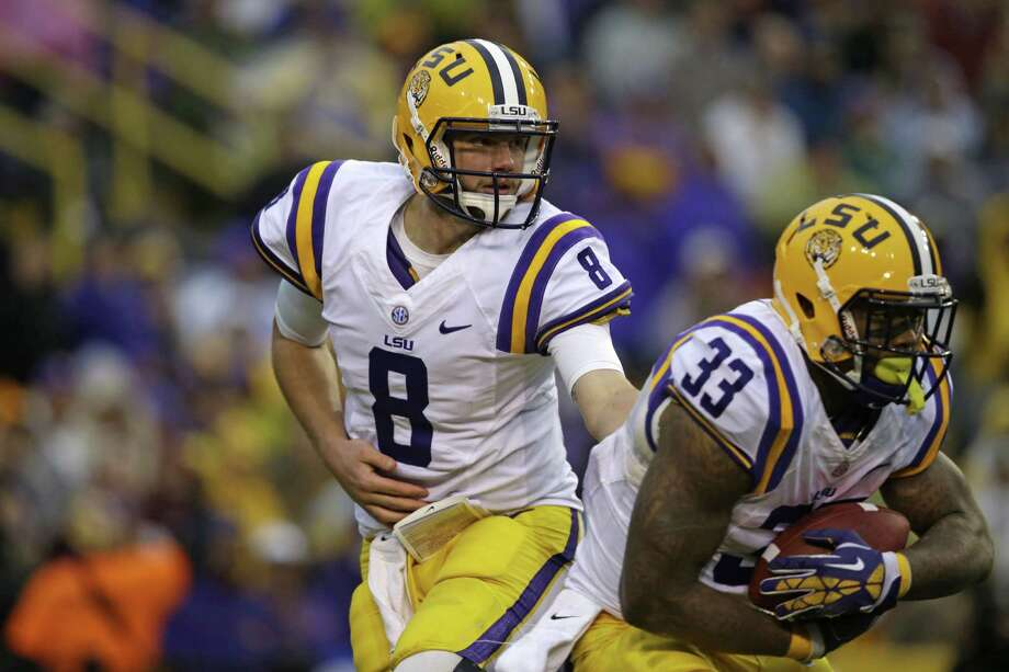 LSU quarterback Zach Mettenberger (8) hands off to running back Jeremy Hill (33) in the first half of an NCAA college football game in Baton Rouge, La., Saturday, Nov. 23, 2013. (AP Photo/Gerald Herbert) Photo: Gerald Herbert, Associated Press / AP
