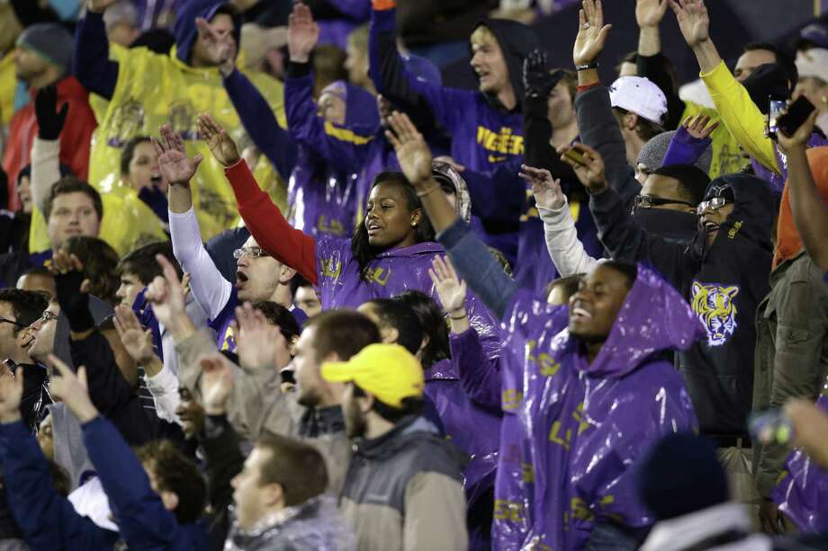 LSU fans chant in the second half of an NCAA college football game against Texas A&M in Baton Rouge, La., Saturday, Nov. 23, 2013. LSU won 34-10. (AP Photo/Gerald Herbert) Photo: Gerald Herbert, Associated Press / AP