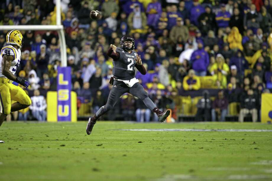 Texas A&M quarterback Johnny Manziel (2) passes in the second half of an NCAA college football game against LSU in Baton Rouge, La., Saturday, Nov. 23, 2013. LSU won 34-10. (AP Photo/Gerald Herbert) Photo: Gerald Herbert, Associated Press / AP