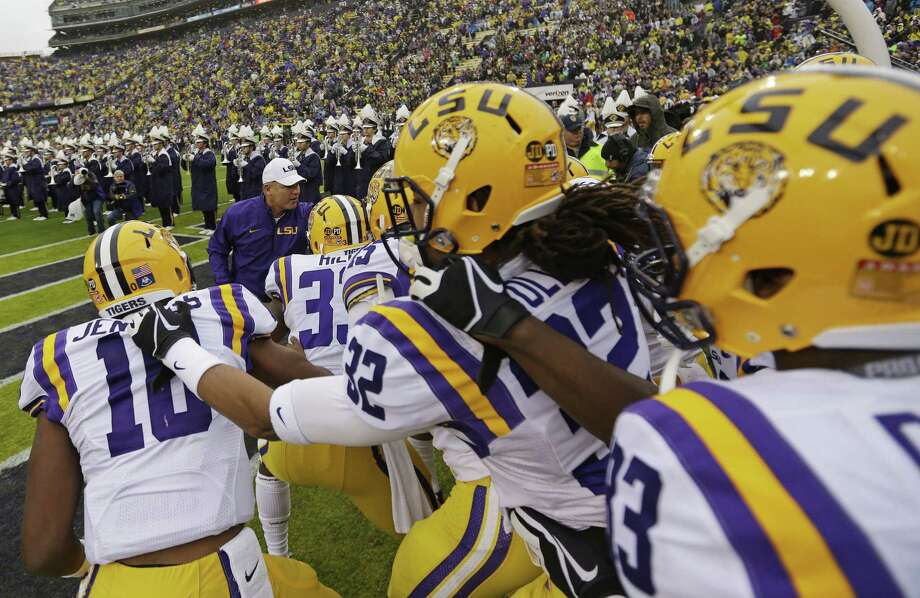 LSU head coach Les Miles leads his team onto the field before an NCAA college football game in Baton Rouge, La., Saturday, Nov. 23, 2013. (AP Photo/Gerald Herbert) Photo: Gerald Herbert, Associated Press / AP