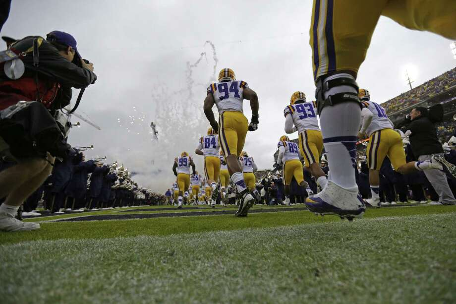 LSU players run onto the field before an NCAA college football game in Baton Rouge, La., Saturday, Nov. 23, 2013. (AP Photo/Gerald Herbert) Photo: Gerald Herbert, Associated Press / AP