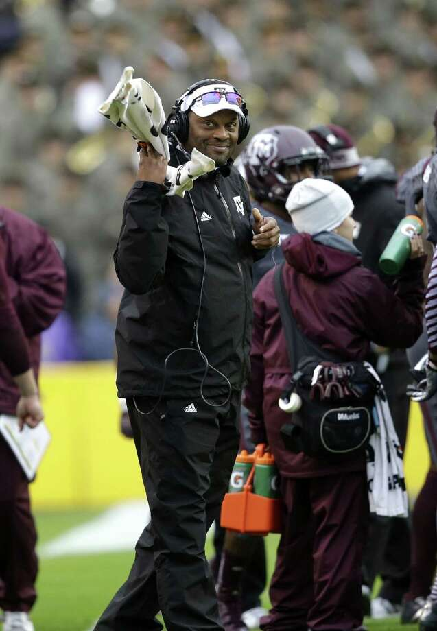 Texas A&M head coach Kevin Sumlin  smiles during a timeout in the first half of an NCAA college football game against LSU in Baton Rouge, La., Saturday, Nov. 23, 2013. (AP Photo/Gerald Herbert) Photo: Gerald Herbert, Associated Press / AP