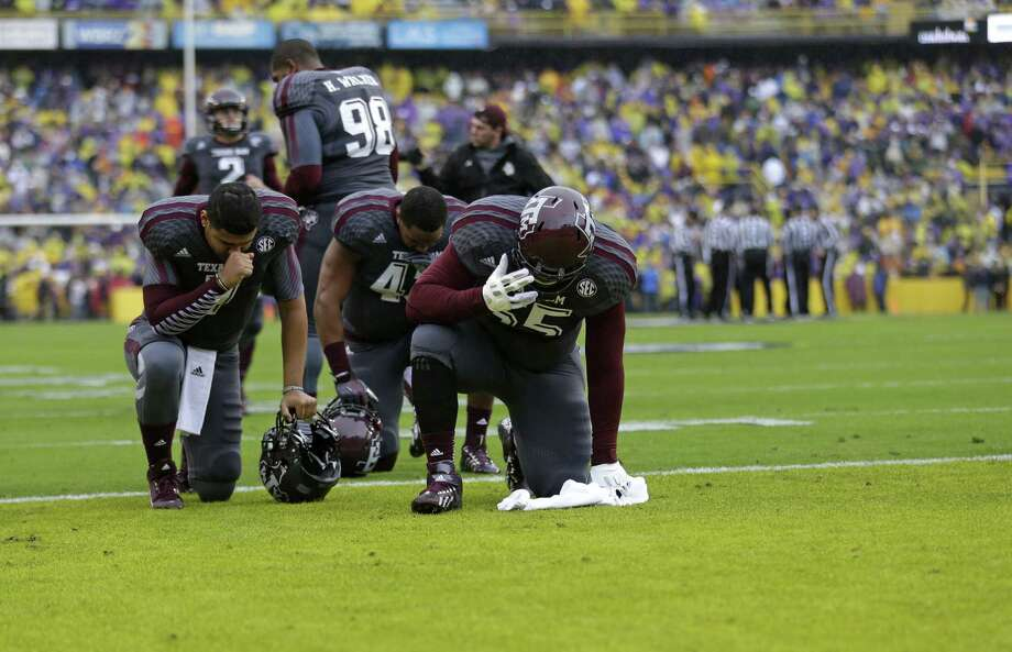 Texas A&M players kneel in prayer before an NCAA college football game against LSU in Baton Rouge, La., Saturday, Nov. 23, 2013. (AP Photo/Gerald Herbert) Photo: Gerald Herbert, Associated Press / AP