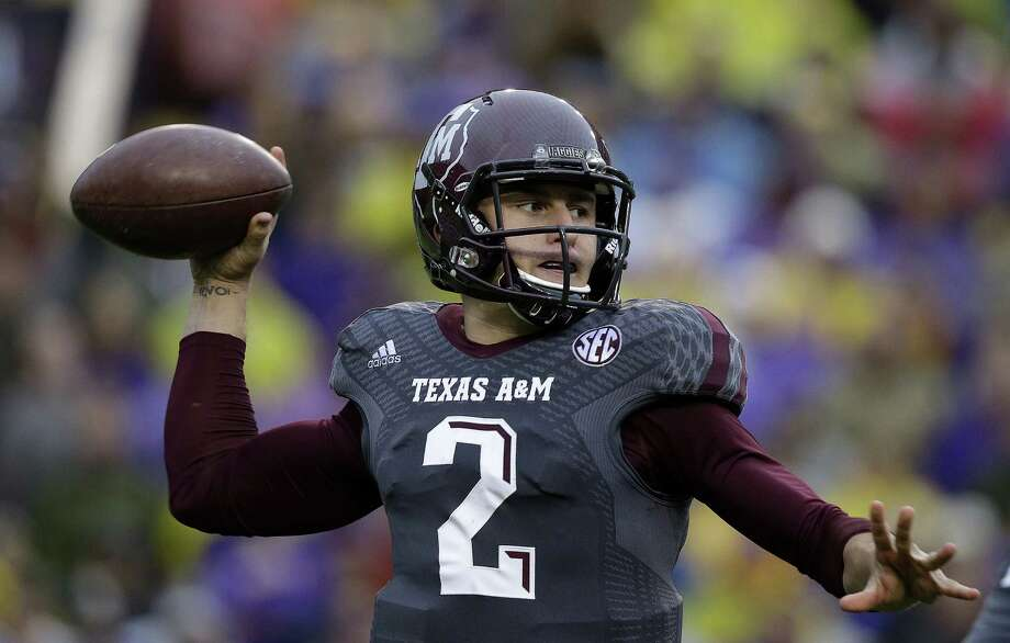 Texas A&M quarterback Johnny Manziel (2) passes in the first half of an NCAA college football game against LSU in Baton Rouge, La., Saturday, Nov. 23, 2013. (AP Photo/Gerald Herbert) Photo: Gerald Herbert, Associated Press / AP