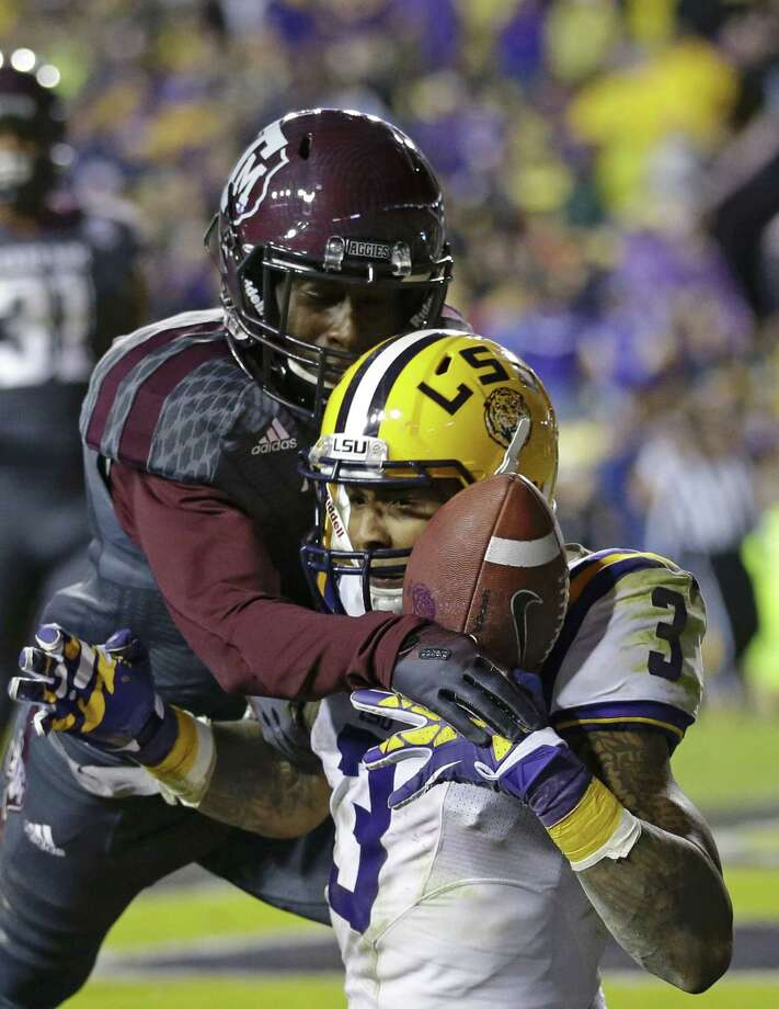 Texas A&M defensive back De'Vante Harris (1) breaks up a pass in the end zone intended for LSU wide receiver Odell Beckham (3) in the second half of an NCAA college football game in Baton Rouge, La., Saturday, Nov. 23, 2013. LSU won 34-10. (AP Photo/Gerald Herbert) Photo: Gerald Herbert, Associated Press / AP