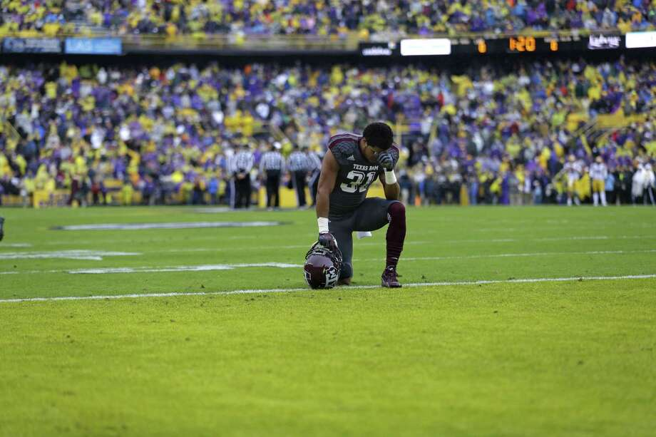 Texas A&M defensive back Howard Matthews (31) kneels in prayer before an NCAA college football game against LSU in Baton Rouge, La., Saturday, Nov. 23, 2013. (AP Photo/Gerald Herbert) Photo: Gerald Herbert, Associated Press / AP