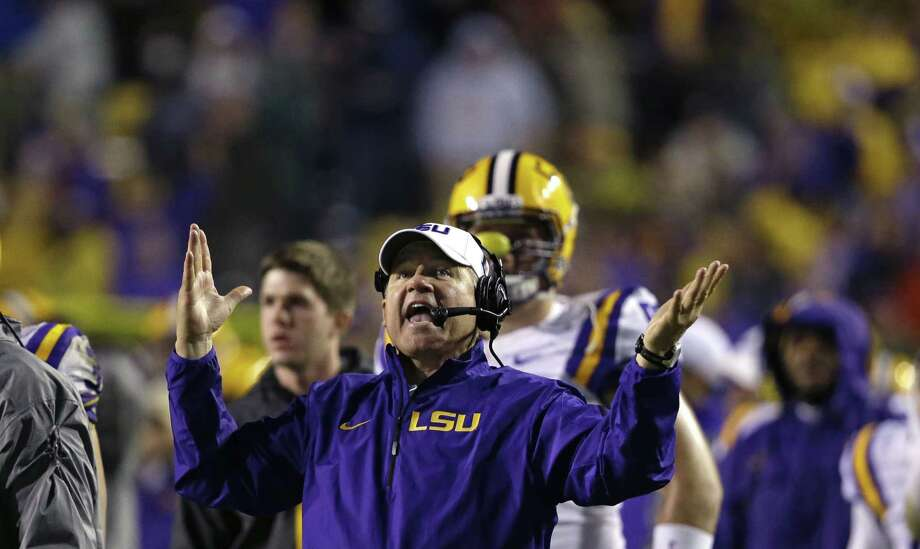 LSU head coach Les Miles reacts to a touchdown call for Texas A&M that was later overturned on replay in the second half of an NCAA college football game in Baton Rouge, La., Saturday, Nov. 23, 2013. LSU won 34-10. (AP Photo/Gerald Herbert) Photo: Gerald Herbert, Associated Press / AP