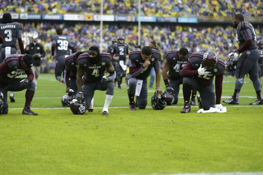 Texas A&M players kneel in prayer before an NCAA college football game against LSU in Baton Rouge, La., Saturday, Nov. 23, 2013. (AP Photo/Gerald Herbert) Photo: Gerald Herbert, Associated Press / AP