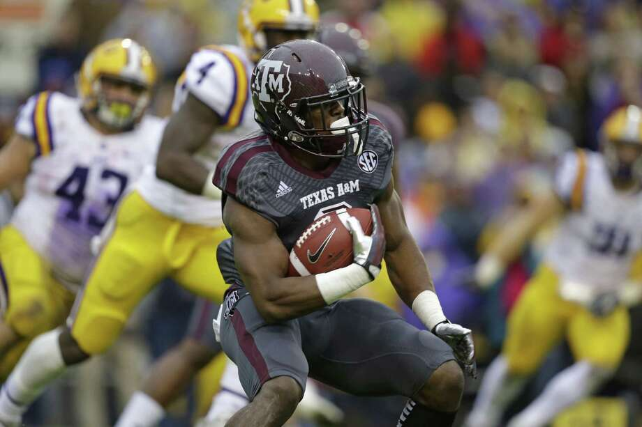 Texas A&M running back Trey Williams (3) carries in the first half of an NCAA college football game against LSU in Baton Rouge, La., Saturday, Nov. 23, 2013. (AP Photo/Gerald Herbert) Photo: Gerald Herbert, Associated Press / AP
