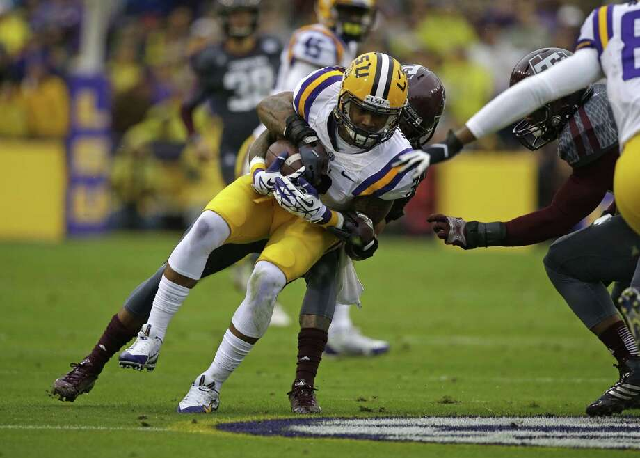 LSU wide receiver Odell Beckham (3) is tackled while returning a punt in the first half of an NCAA college football game against Texas A&M in Baton Rouge, La., Saturday, Nov. 23, 2013. (AP Photo/Gerald Herbert) Photo: Gerald Herbert, Associated Press / AP