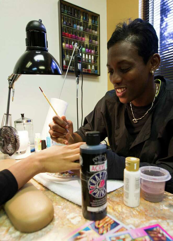 Lisa Beverley, mother of the Rockets' Pat Beverley, works at her salon, Just Tipz and Toez Nail Salon, which Lisa bought with money Pat sent her while overseas. Photo: J. Patric Schneider, Freelance / © 2013 Houston Chronicle
