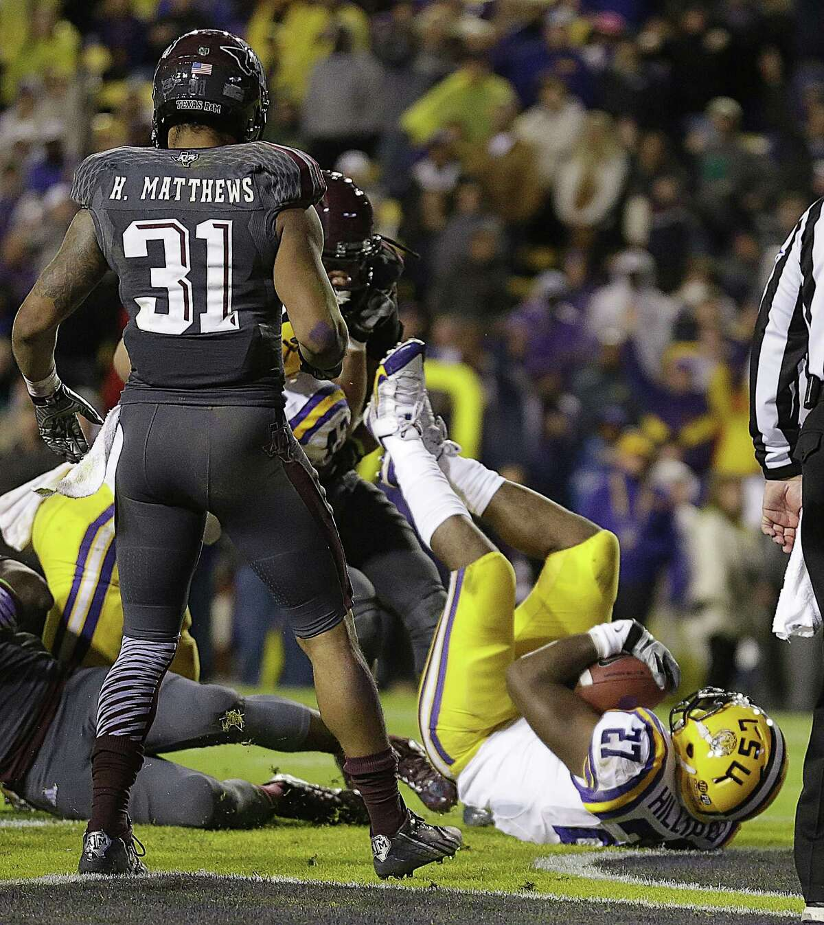 LSU running back Kenny Hilliard (27) dives into the end zone on a rushing touchdown in the second half of an NCAA college football game against Texas A&M in Baton Rouge, La., Saturday, Nov. 23, 2013. LSU won 34-10. (AP Photo/Gerald Herbert)