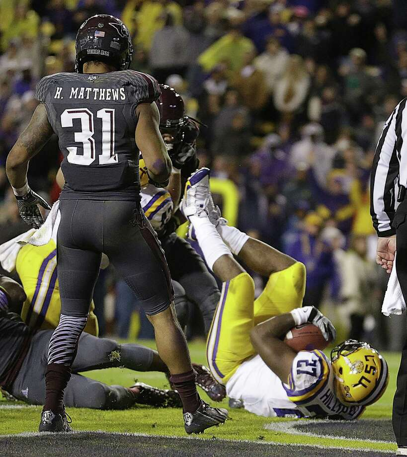 LSU running back Kenny Hilliard (27) dives into the end zone on a rushing touchdown in the second half of an NCAA college football game against Texas A&M in Baton Rouge, La., Saturday, Nov. 23, 2013. LSU won 34-10. (AP Photo/Gerald Herbert) Photo: Gerald Herbert, Associated Press / AP
