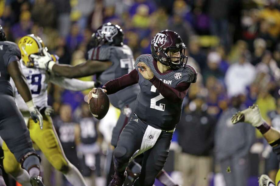 Texas A&M quarterback Johnny Manziel (2) scrambles in the second half of an NCAA college football game against LSU in Baton Rouge, La., Saturday, Nov. 23, 2013. LSU won 34-10. (AP Photo/Gerald Herbert) Photo: Gerald Herbert, Associated Press / AP