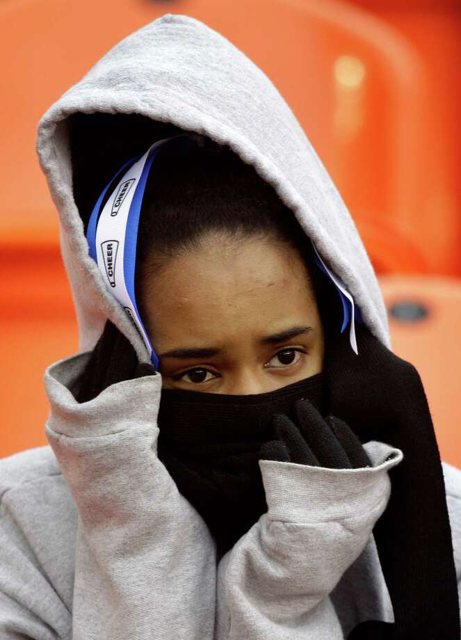 Kennesha Williams braves the cold to watch the University of Houston Cougars face off against the Cincinnati Bearcats during an NCAA football game at BBVA Compass Stadium on Saturday, Nov. 23, 2013, in Houston. Photo: J. Patric Schneider, For The Chronicle / © 2013 Houston Chronicle