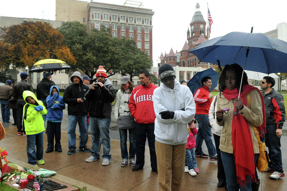 Lela David, right, and Bettysheba Pole of Frisco, Texas, braved the cold and rain in downtown Dallas on Saturday, Nov. 23, 2013,. to tour Dealey Plaza in remembrance of the JFK shooting. Photo: Jerry Baker, For The Chronicle