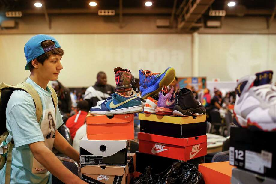 Bryce Lacayo of Houston arranges his shoes in preparation to sell, during the 2013 fall Sneaker Summit, Saturday. Photo: © TODD SPOTH, 2013 / © TODD SPOTH, 2013