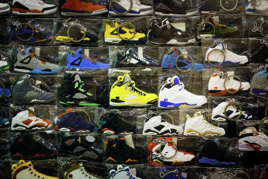 A display of sneaker-related keychains is seen at a booth during the 2013 fall Sneaker Summit. Photo: © TODD SPOTH, 2013 / © TODD SPOTH, 2013