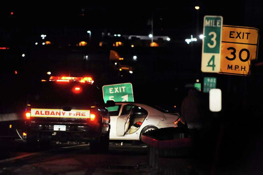 A vehicle involved in an accident on westbound I-90, partially blocks the exit to Everett Road on Saturday, Nov. 23, 2013, in Albany, N.Y. (Cindy Schultz / Times Union) Photo: Cindy Schultz