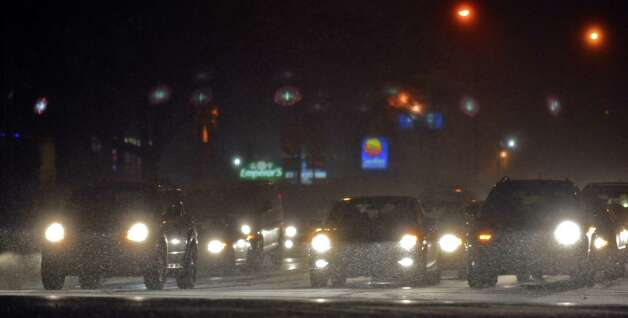 Traffic makes its  their way through the first snow flurries of the season on Wolf Rd. Saturday night Nov. 23, 2013, in Colonie, NY.  (John Carl D'Annibale / Times Union) Photo: John Carl D'Annibale