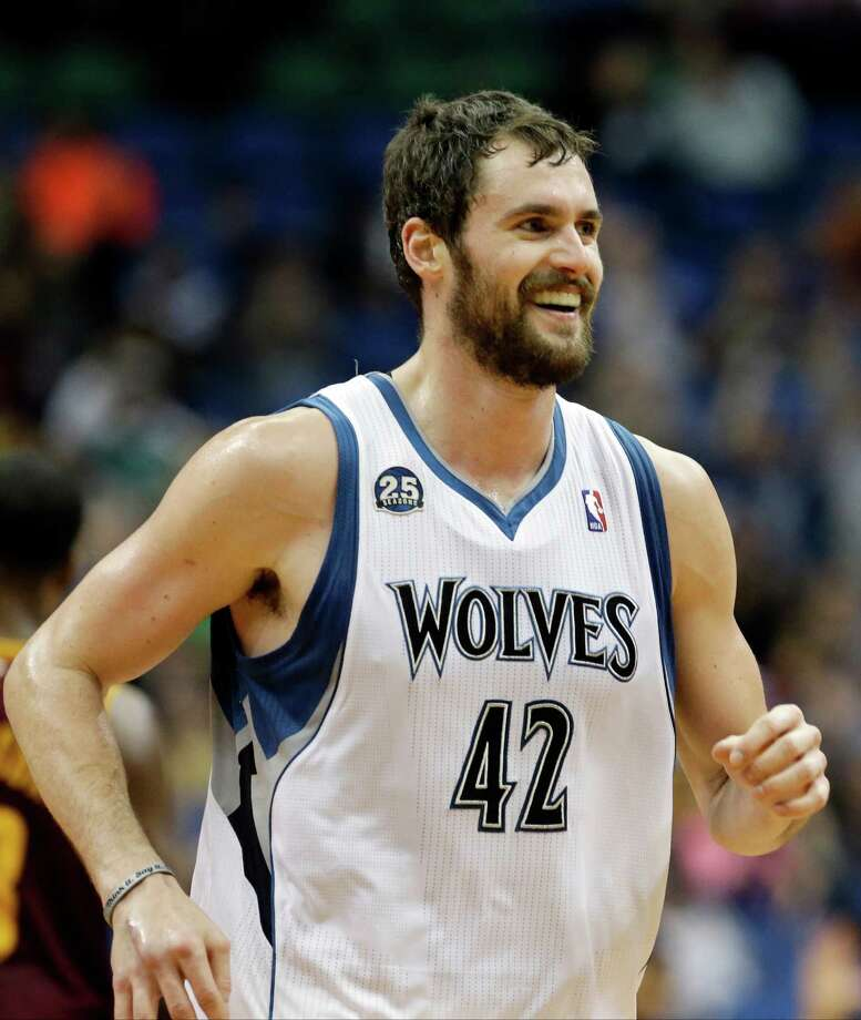 Minnesota Timberwolves' Kevin Love smiles after a three-point shot in the second half of an NBA basketball game against the Cleveland Cavaliers, Wednesday, Nov. 13, 2013, in Minneapolis. Love led the Timberwolves with 33 points in their 124-95 win. (AP Photo/Jim Mone) Photo: Jim Mone, STF / AP