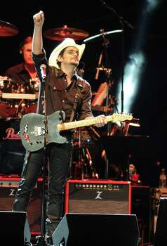 "March 4: Brad Paisley Why go? Paisley is a lively, witty entertainer. And he switches guitars for almost every song. It's fun to keep track of the colors. Song we hope to hear: ""He Didn't Have To Be,"" a sweet love song for good dads. Photo: Frank Micelotta, INVL / Invision"